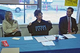 Sarah Palin holding Nowhere Alaska t-shirt