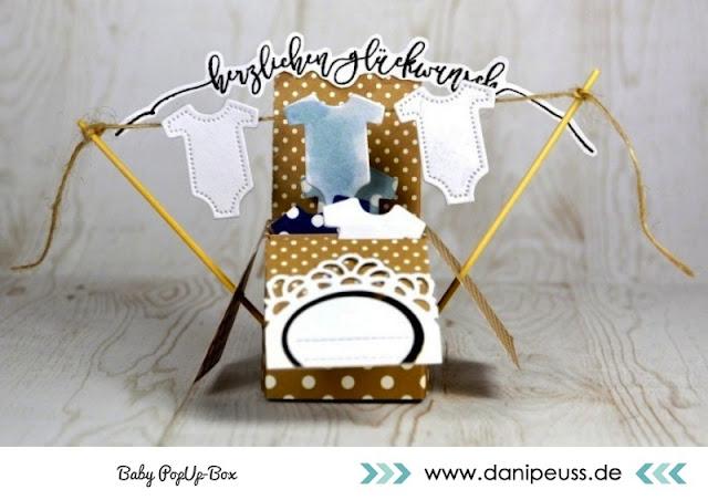 http://www.danipeuss.de/anleitungen-und-tipps/deko-a-geschenke/3291-baby-pop-up-box