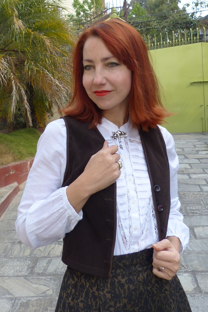 White blouse with brown waistcoat, cat pin
