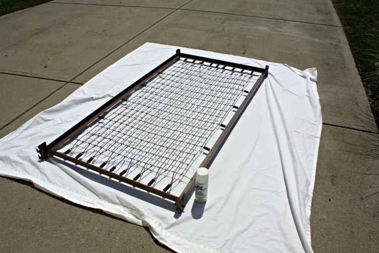 Apply spray paint to the bed frame