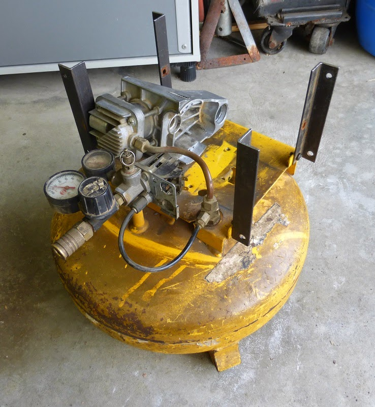 new angle iron mounted on original compressor housing holes