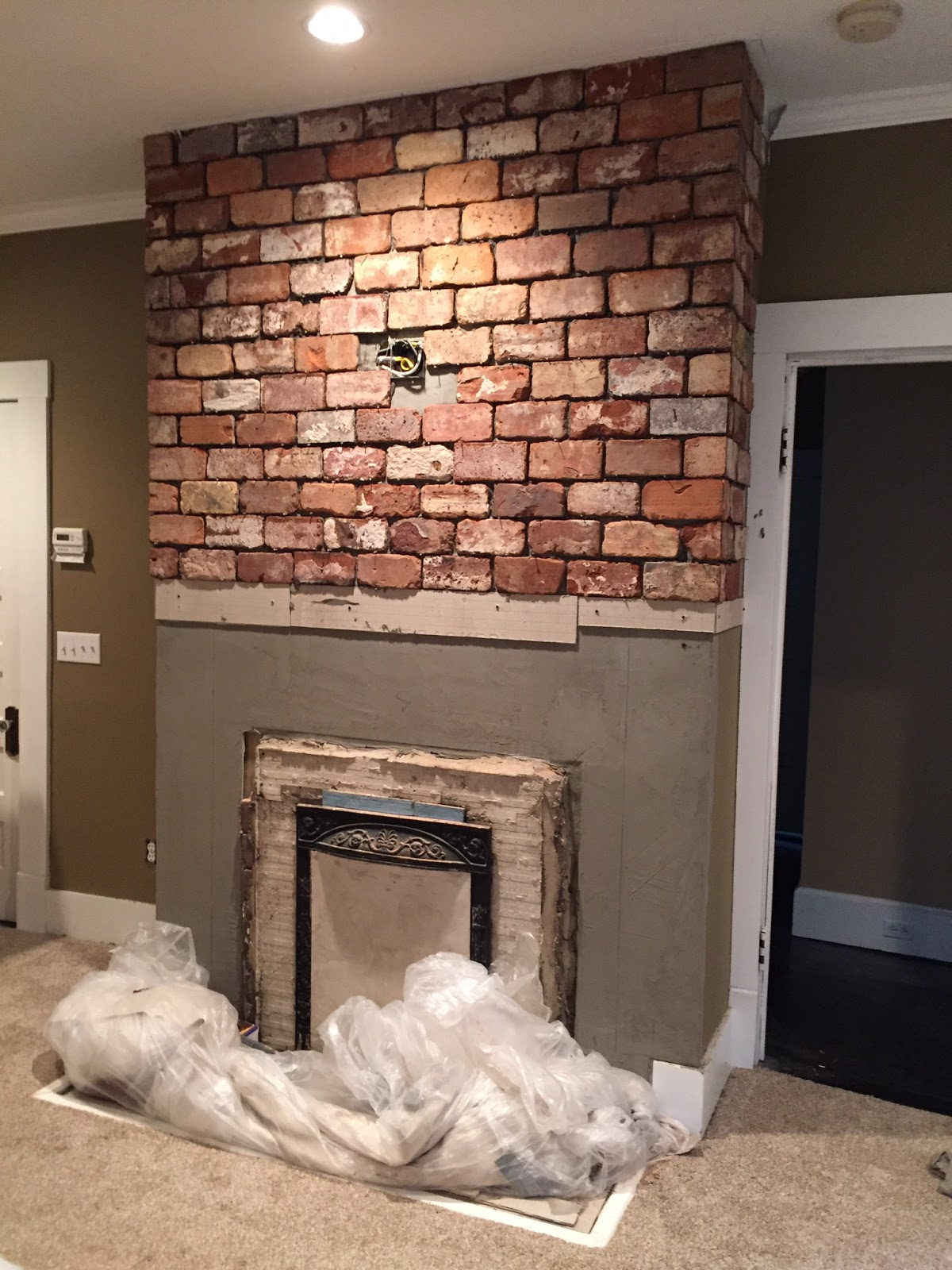 Reclaimed brick tile blog - Tile over brick fireplace ...