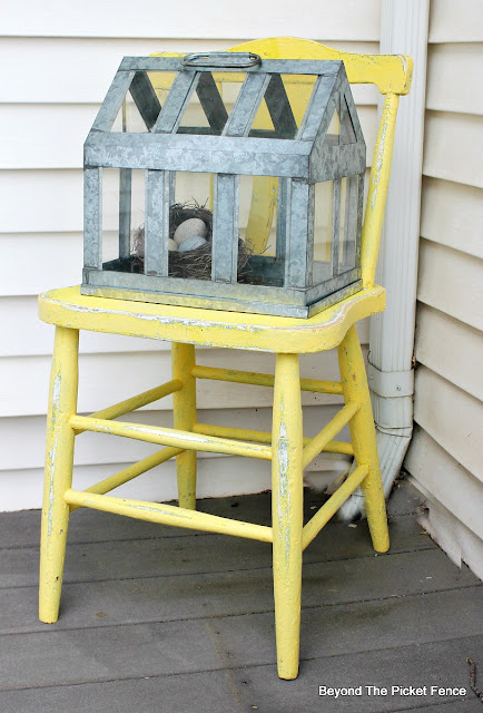 paint a chair sunny yellow for the front porch