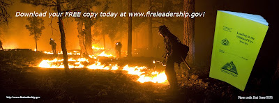 """Wildland firefighters putting fire on the ground at night and copy of """"Leading in the Wildland Fire Service"""""""