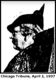 Low-quality newspaper picture of a white woman, in profile, with short curly light-colored hair and a dark hat coming to a sharp peak at the back