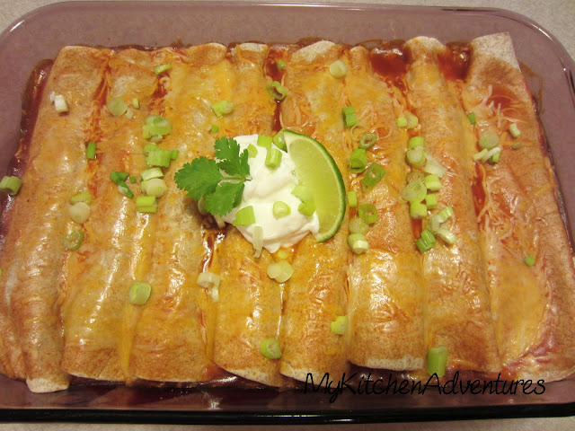 Baked chicken and zucchini enchiladas in pan