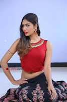 Telugu Actress Nishi Ganda Stills in Red Blouse and Black Skirt at Tik Tak Telugu Movie Audio Launch .COM 0123.JPG