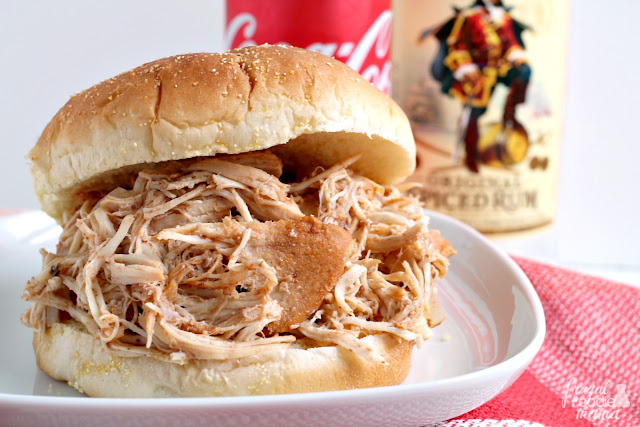 A classic cocktail is transformed into a delicious slow cooker meal that is perfect for game day (or any day!) in this Slow Cooker Captain & Coke Pulled Chicken recipe.