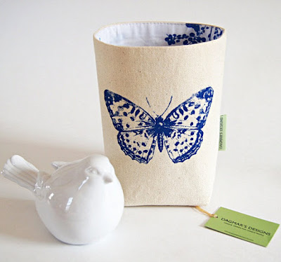 off-white cotton canvas bin with blue butterfly; blue pattern on the interior, too