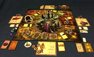 The board laid out with the various components arranged around it to display a game in progress.