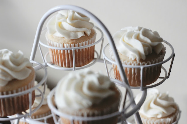 White Cupcakes on Wire Stand