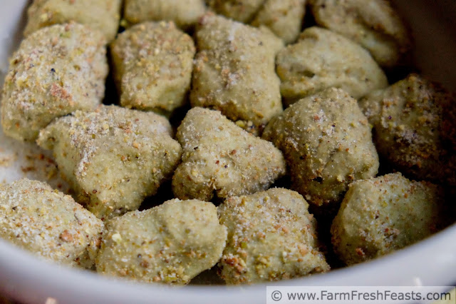 balls of matcha monkey bread dough rolled in pistachios, ready to rise in the fridge overnight