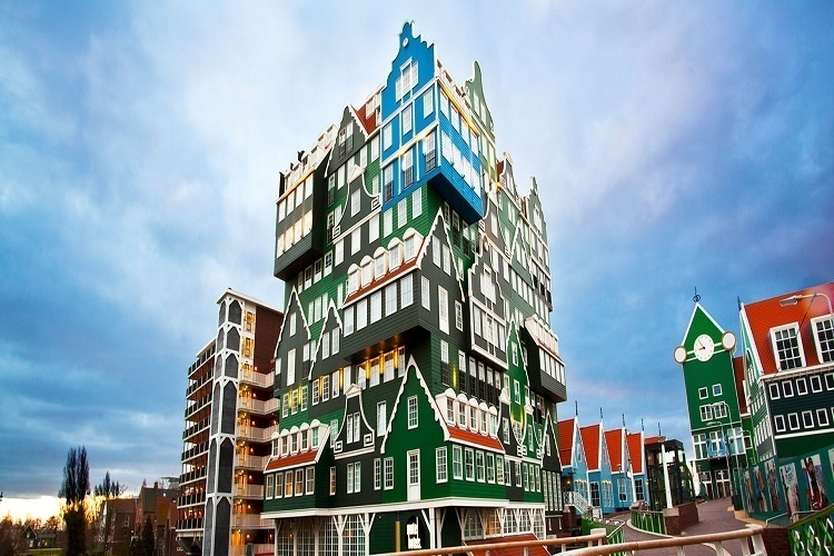 14 Crazy Hotels That Will Give You Serious Travel Goals - The Amsterdam Zaandam Inntel Hotel in the Netherlands looks like a puzzle and takes it's inspiration from historic Dutch architecture: Whimsical, bright, and totally cool.