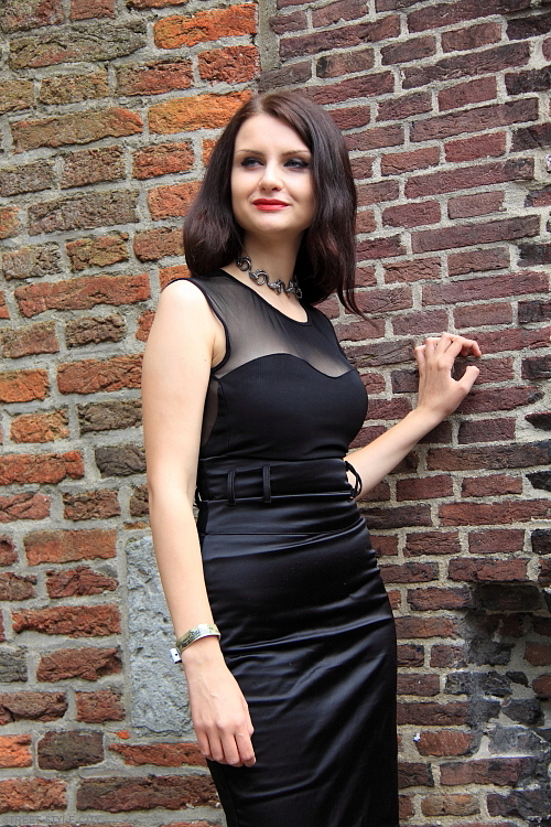 Dutch girl wearing lbd dress in the street. Streetstyle fashion.