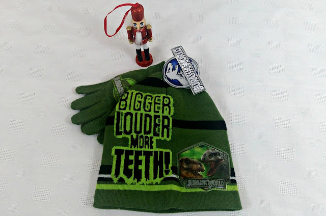 A green children's hat and gloves set, featuring Jurassic World.