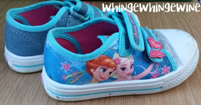 Bright blue glittery Frozen shoes. Awful
