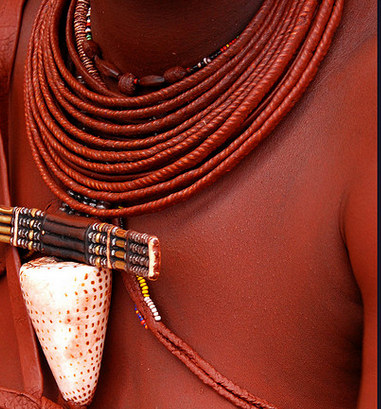 African Himba covers their skin and hair  with a creamy mixture of fat and red clay