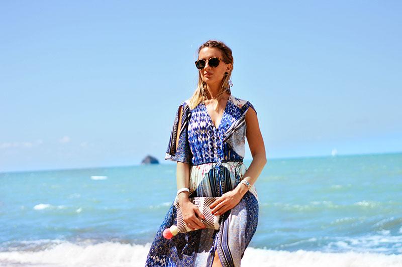 bohemian summer outfit blue boho print hale bon dress with pom pom clutch tory burch sunglasses
