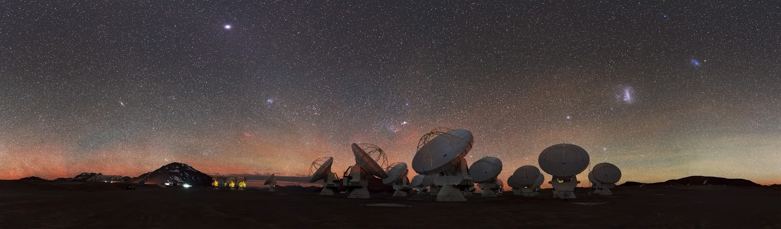 "In Search of Space In Search of Space   At 5000 metres above sea level, high upon the Chajnantor Plateau in Chile, the antennas of the ALMA Observatory peer skywards, scanning the Universe for clues to our cosmic origins. This plateau is one of the highest observatory sites on Earth.  Visible amongst the thousands of stars on the right side of this image are the Small and Large Magellanic Clouds, appearing as luminous smudges in the sky. These cloud-like objects are both galaxies — two of the closest galactic neighbours to our galaxy, the Milky Way.  ALMA's main aim is to observe the coldest and most ancient objects in the cosmos — known as the ""cold Universe"". The array measures radiation emitted in the millimetre and submillimetre wavelengths, which lie in between infrared and radio waves in the electromagnetic spectrum. It features 66 mobile antennas which can be moved and configured over the ALMA site to meet the scientists' requirements, making it the biggest astronomical experiment in existence.  This amazing picture of the ALMA landscape was taken by ESO Photo Ambassador Stéphane Guisard, an optics engineer at the European Southern Observatory's Very Large Telescope in the Atacama Desert, Chile.  Image Credit: ESO/S. Guisard Explanation from: http://www.eso.org/public/images/potw1431a/"