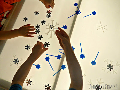 Snowflake light table and fine motor play from And Next Comes L