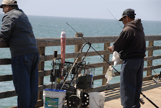 men fishing along the pier