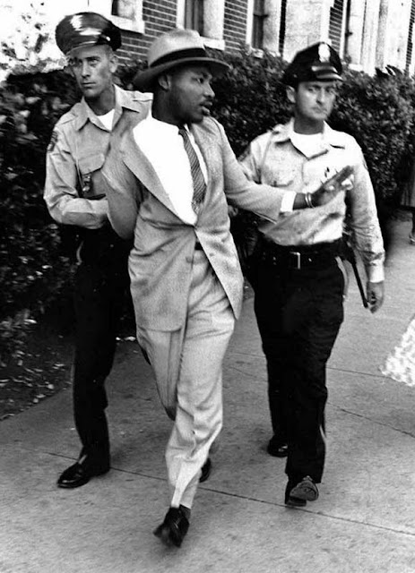 Martin Luther King being arrested for demanding service at a white-only restaurant in St. Augustine, Florida, 1964