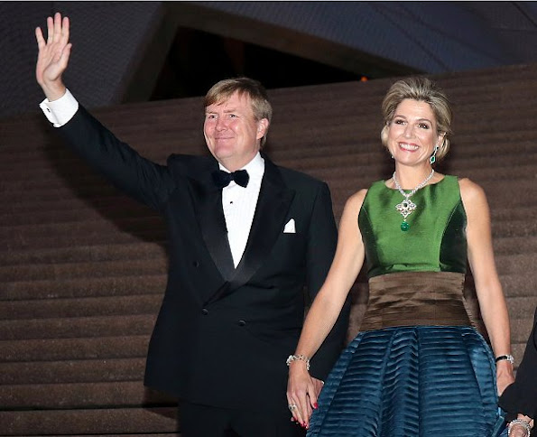Queen Maxima diamond earrings, aqua-marine earrings satin long dress, Natan shoes