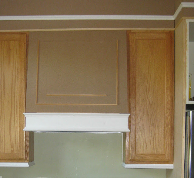 builders grade kitchen upgraded with moldings and paint