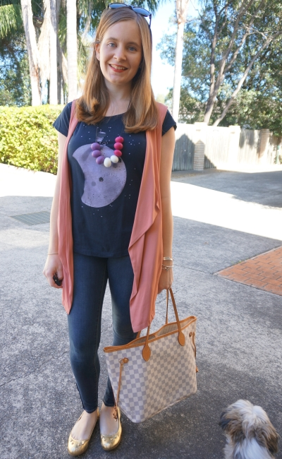 graphic tee and skinny jeans outfit with a pink vest and LV Neverfull bag | Away From Blue