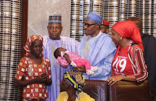 President Buhari and rescued Chibok girl, Amina Ali Nkeki