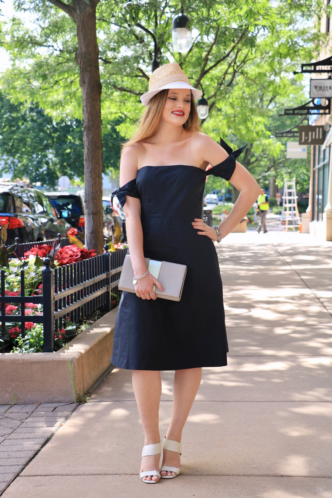 Fashion blogger Kathleen Harper of Kat's Fashion Fix wearing a black dress