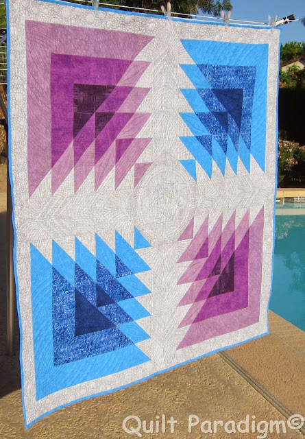 http://quiltparadigm.blogspot.com/2015/04/triangle-transparency-blog-hop-shock.html