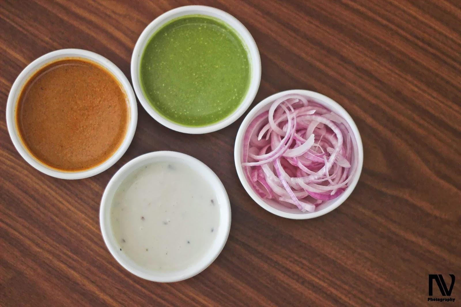 Mirchi ka Salan, Burrani Raita, Hari Chutney and Onions