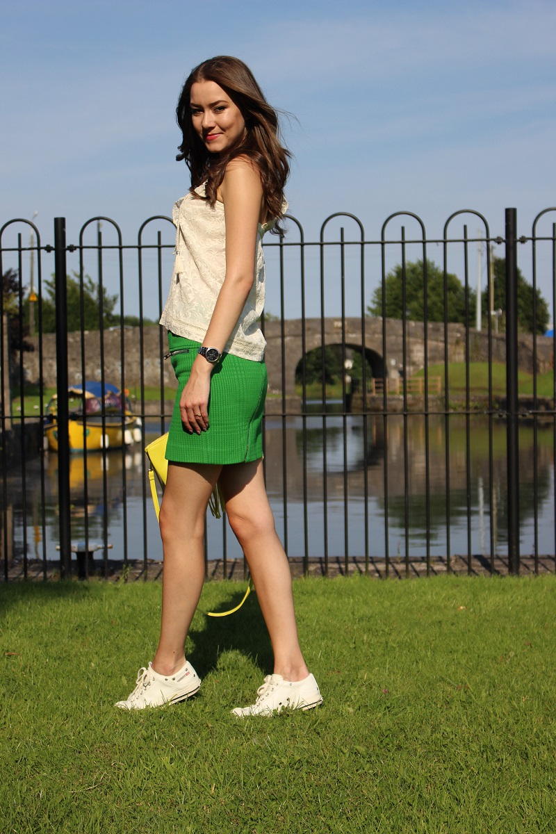 diesel sneakers and green skirt