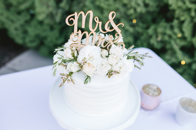 full, white cake blooms including garden roses and herbs for a classic garden wedding in utah