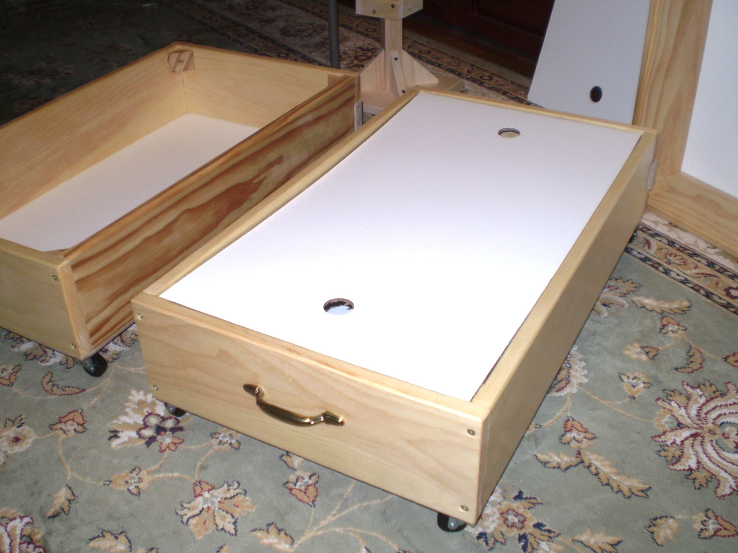 Jeri s organizing decluttering news under bed storage for Wooden box bed image