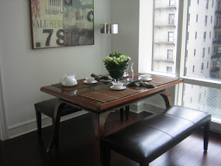 Small Wooden Dining Room Tables For Small Spaces near some Low Black Benches and Glass Walls