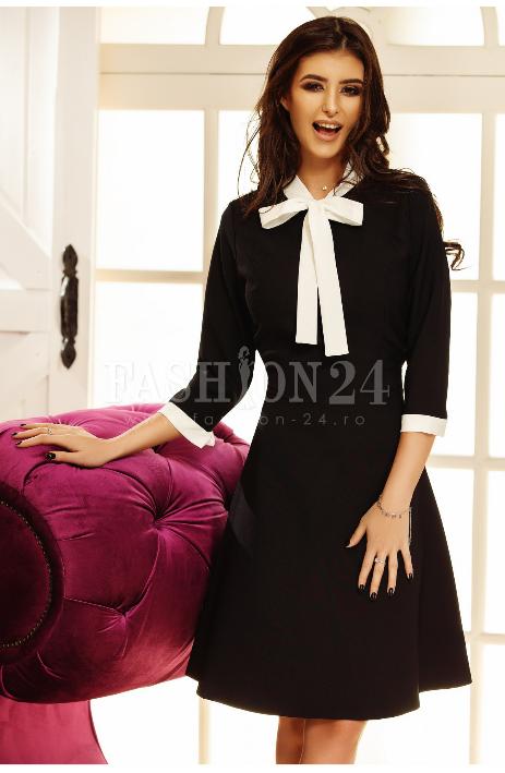 Rochie eleganta de seara, neagra, in clos, cu fundita in dreptul bustului, decolteul rotund, manecile trei sferturi
