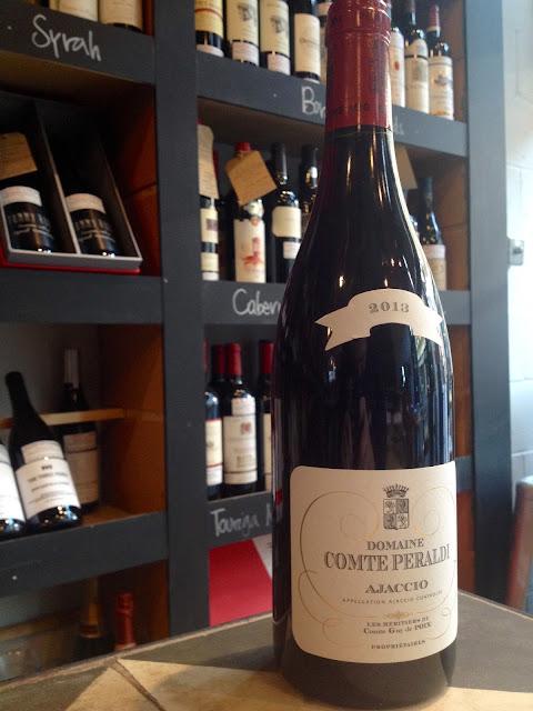Bottle of Domaine Comte Peraldi Ajaccio wine in wine shop