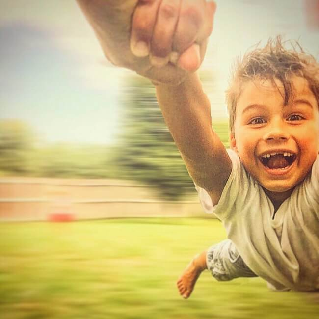 22 Photos That Utterly Capture Powerful Feelings - 'My nephew challenged me to spin him around as fast as I could.'