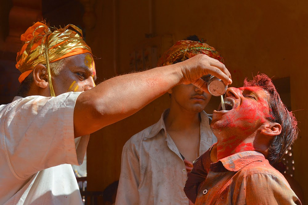 Indian man male drinking bhang cannabis Dauji Temple Mathura Holi Huranga 2015 women men playing