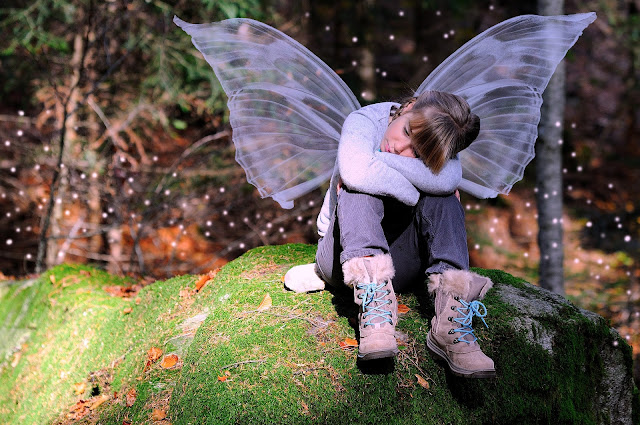 Child Dressed Up Like a Fairy, Waiting . . .
