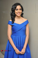 Actress Ritu Varma Pos in Blue Short Dress at Keshava Telugu Movie Audio Launch .COM 0040.jpg