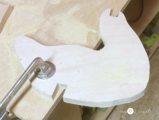 notching out wooden reindeer puzzle pieces with a jig saw