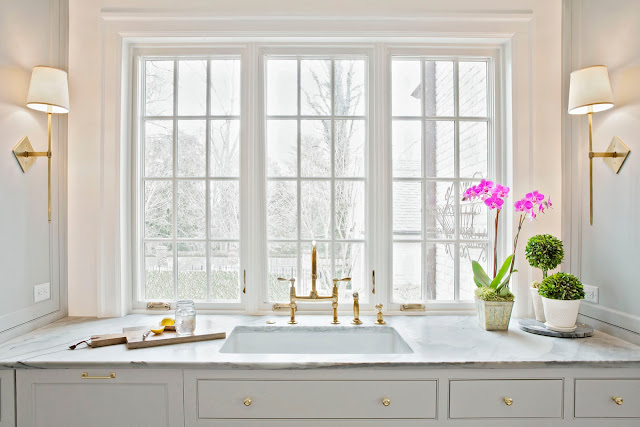 Gorgeous kitchen sink with window and sconces by Rachel Halvorson - found on Hello Lovely Studio