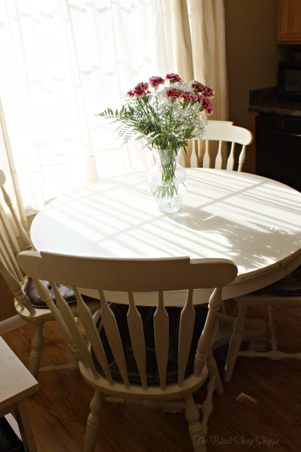Old ochre chalk paint was used on this table and chair set.