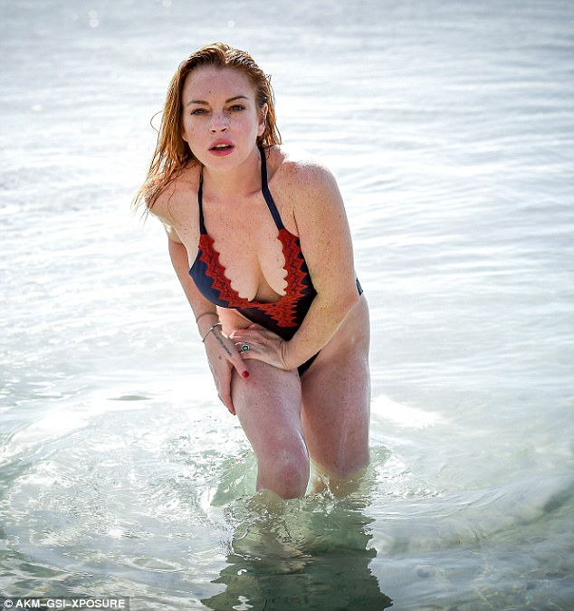 Lindsay Lohan flaunts plunging swimsuit on Mauritius beach