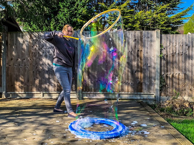 a person size bubble created with The Mega Loop from Uncle Bubble