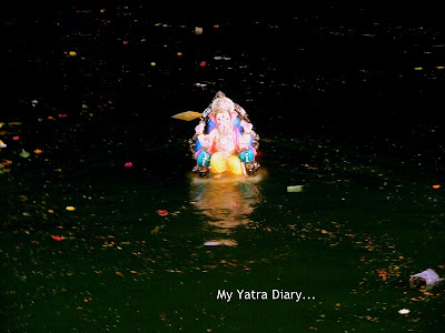Ganesh Visarjan in an artificial lake in a local temple in Mumbai