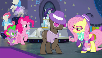 Fluttershy (right) looks angry at a brown customer stallion in a purple hat. Pinkie and Spike look on worriedly from the left